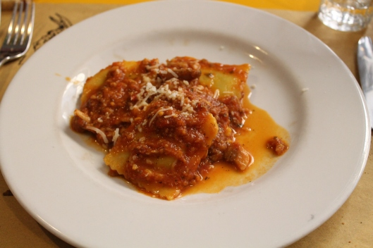 Ravioli sauced with tomatoes and mushrooms.