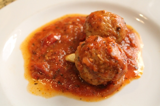 Turkey meatballs braised with tomatoes.