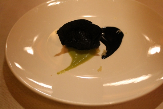 A crisp dumpling filled with whipped bacala, with squid ink and ginger.
