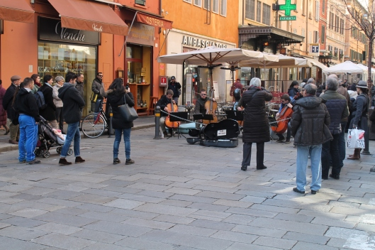 People, actually stopping and listening to classical musicians performing in the street.